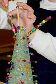 Fine Motor Christmas Trees - Holiday Fun for Little Hands from www.fun-a-day.com -- A super fun, super easy, Christmas-themed invitation to play! Let the kiddos get their fine motor skills working while creating awesome open-ended 3D art!