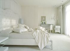 Beautiful, White Tufted Headboard Command Attention In This All White  Bedroom.