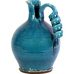 Perfect vase for a Aquarius. ... Ceramic Vase with a spiral handle in turquoise.Product: VaseConstruction Material: CeramicColor: Turqu...