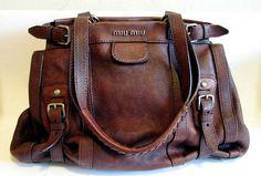 Distressed handbag.  Prada.