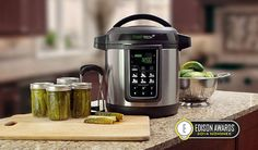 i know that seems backwards.but I kinda think I must have one! Ball® FreshTECH Automatic Home Canning System Jelly Maker, Jam Maker, Pickled Hot Peppers, Canning Peppers, Carrot Cake Jam, Water Bath Canning, Home Canning, Canning 101, Canning Jars