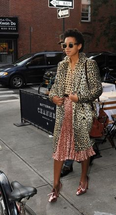 Long leopard print coat + pink and black spotted midi skirt + peach and black spotted blouse