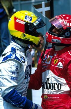 Ralf Schumacher (GER) BMW Williams, left, congratulates brother Michael Schumacher (GER) Ferrari on his win. German Grand Prix, Rd12, Hockenheim, Germany., 28 July 2002