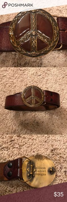 Allison Daniels Designs Peace Sign Belt Beautiful but subtle flower patterns leather with an enameled peace sign for the buckle. The leather is super luxe and almost a 1/4 of an inch thick. Unfortunately I thought I was cool back in high school and wrote my name on the inside of the belt. Doesn't show from the outside. Purchased at the Broadmoor Boutique in Colorado Springs. Small wear from where I wore it buckled. See photos Allison Daniels Designs Accessories Belts