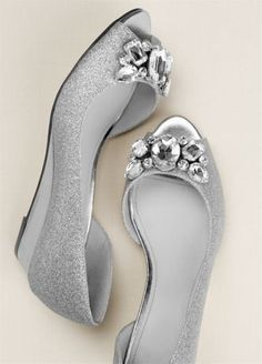 "This low peep toe wedge features a crystal cluster embellishment that will sparkle the whole night through!  Heel height: 1 1/4"".  Imported."