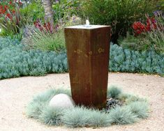 Fountains are an easy low-maintenance water feature for gardens. This vertical Fountains are an easy