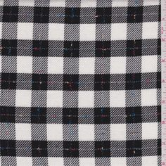 "Ivory and black 1"" check with bright blue, pale red and yellow accent threads. This medium weight rayon fabric has a very soft hand and a beautiful drape.Compare to $12.00/yd"