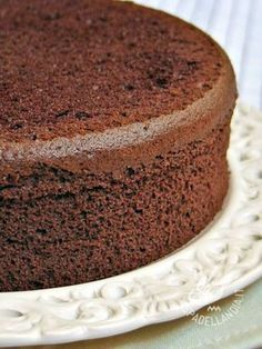 Chocolate chiffon cake is a light and spongy cake. Goes well with a heavy chocolate ganaché coating. Line bottom only of cake pan with parchment paper cut to fit. Chocolate Chiffon Cake, Chocolate Sponge Cake, Chocolate Cupcakes, Chocolate Recipes, Chocolate Genoise Cake Recipe, Sponge Cake Recipes, Love Cake, Sweet Recipes, Cupcake Cakes