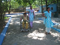 Divya on the wheel chair accompanied by our staff Malar during the outing to the zoo. The Banyan, Chennai.