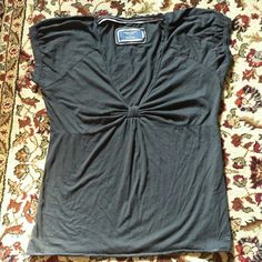 XL Black American Eagle T Knotted V Neck t-shirt This is a beautiful, V neck top in a very soft cotton from American Eagle. This top is an XL size, and creates a gorgeous neckline and focal point. Perfect condition- no rips, snags, or stains. Great piece for going out with the girls, a date night with the boo, or can even be paired with cute leggings for a cozy night in! Lots of uses for this top!!  Please Note!!! When viewing the photos- this shirt *is* to big for me. Please use it as a…