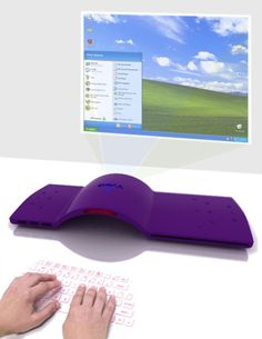 Industrial designer, Pauline Carlos, has come up with a rather interesting design for a Dell sustainable design contest. The Froot, as it's called, will do away with your traditional monitor as well as USB keyboard.