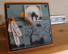 """Stamps: Batty for You, SA Spooky Skyline and Autumn Apparitions Paper: Basic Black,Pumpkin Pie and Glossy White Ink: Basic Black, Bordering Blue Accessories: Black Gingham and Tangerine Grossgrain Ribbon, Black Brads, Metal tag and Stickles Tools: Brayer, Dimensionals, 1/16"""" Punch, 13/8"""" Punch, and Window Punch"""