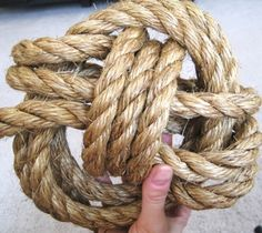 Learn how to tie the monkey fist knot: http://www.completely-coastal.com/2010/08/tying-monkey-fist-knot-with-rope.html Use it as door stop... or decorative nautical accent on a shelf, for example.