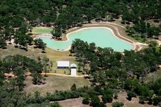 Beautiful ranch property 1 hour from Houston and minutes to Bellville or Brenham. Features include a stocked lake with piers and waterfall, 3 BR home built in 09, Barnmaster horse & equipment barns, manager's house, game fencing, firepit, Playwood play set, and much more. Perfect combination of cleared areas and dense woods. Horse or four-wheeler paths cleared throughout property. So pristine that even the electricity to both house and barn is underground.