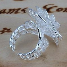 '.925 adjustable flower ring ' is going up for auction at 11am Thu, Dec 13 with a starting bid of $8.