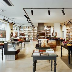 """Kochhaus Berlin is the food market store for the """"gourmet-chef-wannabe"""". Designed by branding and design agency Fitch. Shop Interior Design, Retail Design, Store Design, Gourmet Food Store, Gourmet Recipes, Food Retail, Retail Shop, Retail Interior, Cafe Interior"""