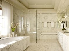 Bathroom: love the mirrors and glass-walled shower, but the tub looks like a tissue box....