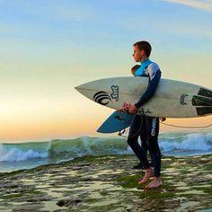 Surf...almost looks like he's walking on water