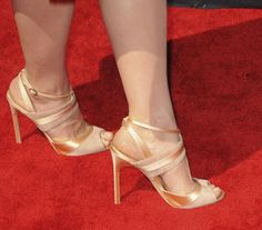 Crystal Reed wearing blush suede and champagne-colored leather Manolo Blahnik sandals