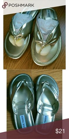 Brand new Steve Madden silver flip flops Brand new Steve Madden silver flip flops. Size tag says 7.5. From tip to tip is 9.5 inches. Measuring based on the stitching is 9 inches. Super cute!  The soles have curved a bit but I'm guessing they'll straighten when worn.   #supercute #silverflats #stevemadden #brandnew #flipflops #neverused Steve Madden Shoes Sandals