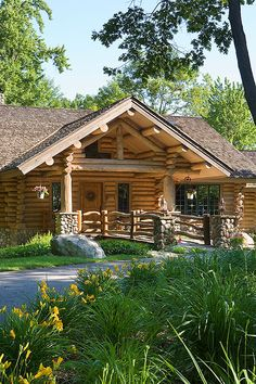 Log Home...love the bridge made of white oak logs and planking over a dry creek bed leading to the red oak front door.