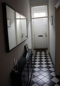 Black and White tiled floor entryway