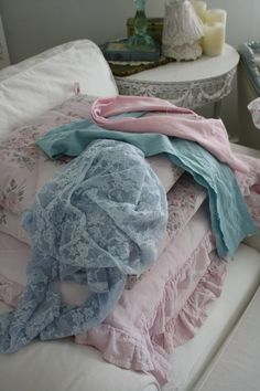 Vintage overdyed lace on top of pink pillows.