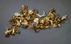 The final results are beautiful and seem to be of another time and place.  http://www.viralnova.com/jennifer-trask-bone-sculptures/