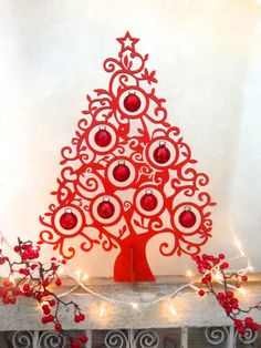 This wonderful tabledecoration curltree xmas tree creates an own atmosphere on your dinning table. The tree is made out of 3mmm wood and is covered