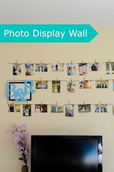 Easy Photo Display Wall - using bakers twine, nails, and clothespins.