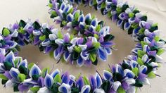 The lei is approximately 37 inches long material/satin ribbon/organza ribbon