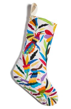 Add a colorful touch to the Christmas decor with this hand-embroidered stocking.