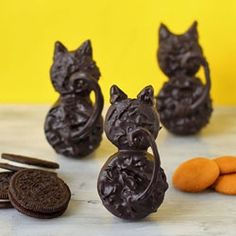 Backside Black Cat Cookies made from chocolate dipped Oreos and vanilla wafers are perfect for Halloween.