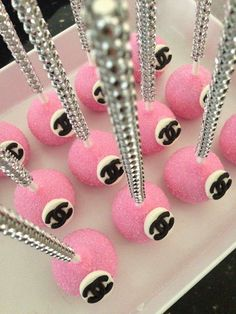 Pretty pink cake pops at a Chanel baby shower party! See more party planning ideas at CatchMyParty.com!