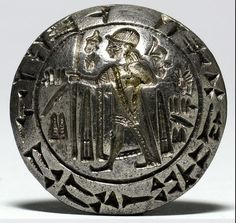 Bilingual Seal of a Hittite King - Hittite, 1400 BCE. In the center of this silver seal, an inscription in hieroglyphs (i.e., logograms) bears the name of Tarkummuwa, King of Mera, and the inscription is repeated in Hittite cuneiform along the rim. Discovered at the Turkish site of Smyrna, this bilingual seal provided one of the first clues to deciphering the hieroglyphic script native to ancient Anatolia.