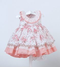 Sweet Dress with lots of ruffle layers. Love the rose print with the pink. The tiny rose print bias neck helps the collar ruffle stay down.