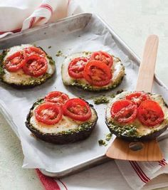 4 Portobello mushroom caps  1/2 cup basil lemon pesto   4 ounces fresh mozzarella, sliced 1/4-inch thick  4 Campari tomatoes or other vine-ripened tomatoes Preheat oven to 425 degrees F. Spread 2 tablespoons of pesto in each mushroom cap. Top with mozzarella and tomato slices, enough to cover the top of each mushroom.  Place pizzas on a baking sheet and bake in the oven until the mozzarella is melted (about 10 minutes).