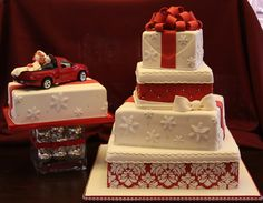 Christmas Wedding Cake Bride wanted cake to look like stacked presents but still look elegant. Had a lot of trouble with my red fondant...
