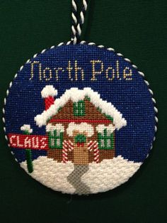 North Pole picture on circular plastic canvas