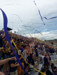 A frequent site in the JMU student section, the sky filled with purple and gold!