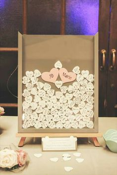 Sign the hearts with words of wisdom for the bride & groom