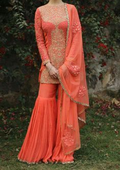 This orange sharara with dori and mirror embroidery by is something new to try this wedding season 👗👍 Eid Outfits, Pakistani Outfits, Indian Wedding Outfits, Indian Outfits, Indian Clothes, Wedding Gowns, Traditional Fashion, Traditional Dresses, Ethnic Fashion