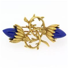 1970s Tiffany & Co. Schlumberger Lapis Lazuli Gold Brooch | See more rare vintage Brooches at https://www.1stdibs.com/jewelry/brooches/brooches