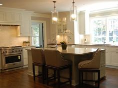 Open Kitchen - Transitional White Kitchen on HGTV LOVE this kitchen, especially the island with chairs!