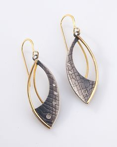 Perfect for day or night, these modern earrings are sure to be your go to for any occasion. Gold Layered Earrings by Megan Clark: Gold & Silver Earrings available at www.artfulhome.com