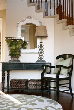 Great room makeovers on this site.  For my home, two baskets under the gateleg table to hold throws, etc.