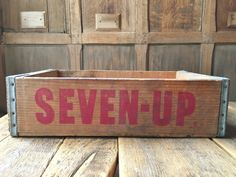 VINTAGE 7UP CRATE, WOOD SODA CRATE, SEVEN UP CRATE, RUSTIC HOME DECOR, VINTAGE HOME DECOR  Very nice vintage SEVEN UP crate. Thick wood walls, solid construction. Red logo and script still bright. Print on all four sides. Very good condition overall, displays great. Light surface scuffs, scratches, typical wear and tear. Thoroughly cleaned and ready to repurpose. Use as decorative storage, or hang on a wall as a little shelving unit.  Check out our other crates and decorative storage here…