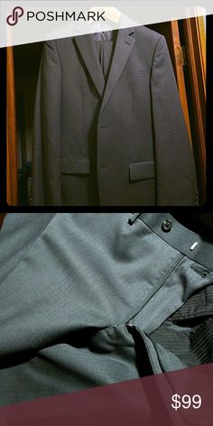 Michael Kors Men's Suit Modern, flat front trousers and accompanying sport coat in charcoal gray. The jacket: 38L, two-button, slim fit, 100%wool, dry clean only. Pants: do not have a size tag, but measure 32 waist, 33 inseam. This suit is designed for a tall, slender man and is measured in a European size. MICHAEL Michael Kors Suits & Blazers Suits