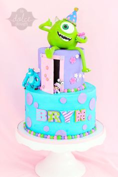 Monsters Inc Birthday. The Birthday girl wanted Monsters Inc. and Marshmallows! So, on her personal cake Sullys eyes and teeth are marshmallows. is RKT with gumpaste/fondant. Cake is covered with Buttercream and decorated with fondant accents. Monster Inc Birthday, Monster Inc Party, Fancy Cakes, Cute Cakes, Beautiful Cakes, Amazing Cakes, Monster Inc Cakes, Birthday Cake Girls, Cake Birthday