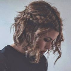 messy curly bob with braid hairstyle